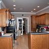 Kitchen, shot toward dining room and front of house