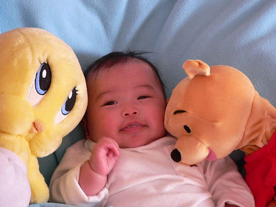 Laying with Pooh and Tweety.