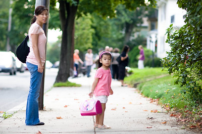 Mom walking Alyssa to preschool.