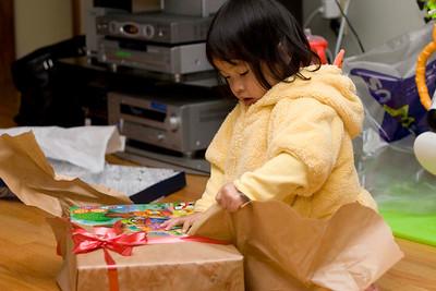 Alyssa opening up more presents.