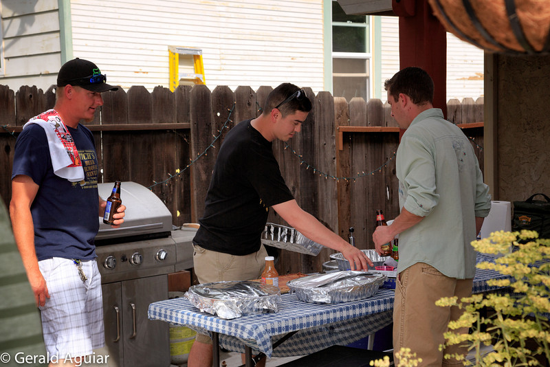 Mitch, Tony and Brian getting ready to finish cooking the ribs