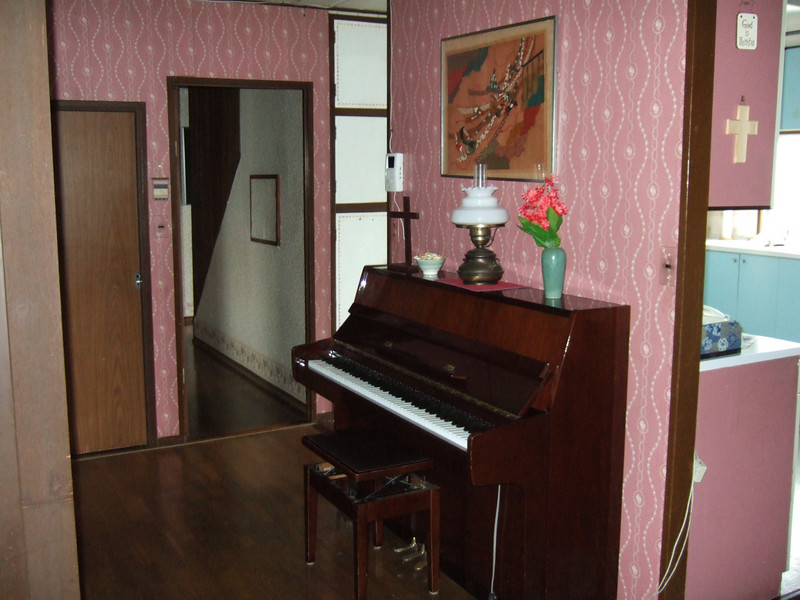 my piano by the entry way