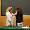 AMber receives her pin from Angela Breault, Program Director.
