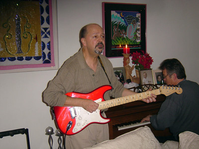 Tommy playing his electric guitar (Christmas party: Dec 2005)