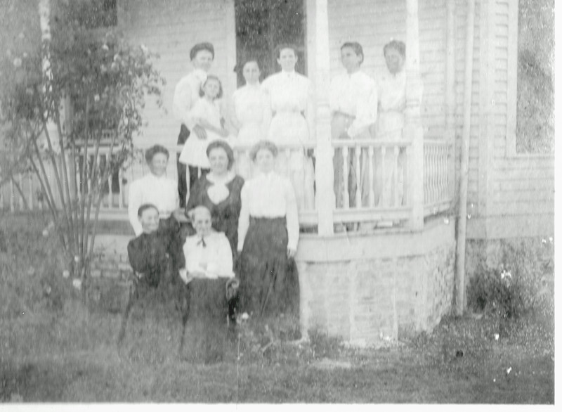 E2d Eliza Welhausen (left sitting) & other ladies on side porch - fuzzy