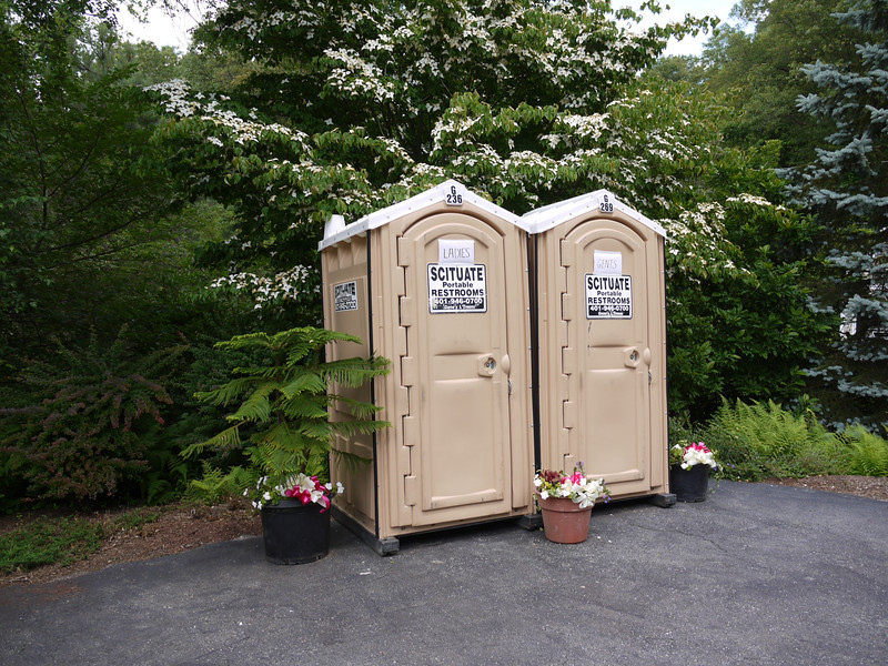 Designated as an official Charmin test site, these portable restrooms would have blended in much better if they didn't have such bold advertisement signage on them. Perhaps 'Dainty Ladies Portable Resting Lounge 401-946-0700' in lavender and 'Tough Guy's Mobile Gaming Closet 401-946-0700' in forest green? The flower pots were a very nice touch and the location was excellent. Beige goes with everything. With the family room rug issue the Champi's just resolved, don't ask about the red carpets to these facilities!