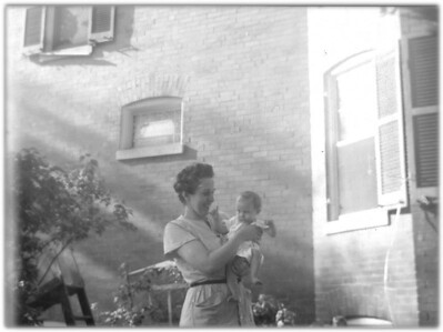 First Time I have seen this photo from a negative.  Taken in the yard of 4431 Georgia Av, D.C.  May be mom with Beryl