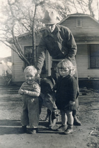 9. Gordon Lindy Gene Moore, with Gordon Ray Simmons (oldest son of Vera Moore Simmons), a calf, and Gail Maxine Moore; 1946-ish; Days Creek Cutoff, Myrtle Creek, OR.   [You'll notice in many of these photos Lindy is usually wrestling some sort of livestock. GJ]