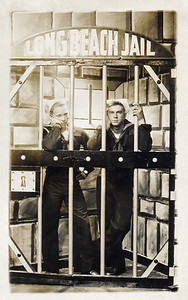 42. Gordon (Lindy) Moore and his friend Eddie(?) when they were at Long Beach Naval Base, CA, c.1947.   [Just clowning, they aren't really in jail, though maybe they should have been.]