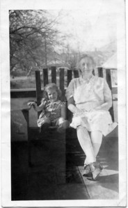 Nancy sitting next to Grandma James on her front porch