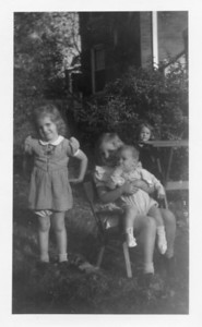Nancy (L), Beryl seated, Billy taken in yard of Georgia Ave house...billy was born in 1945, so phot is probably 1946