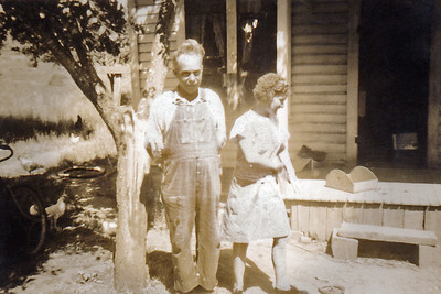 "23. Rube and Evie Moore, c. 1940, Days Creek Cutoff, Myrtle Creek, OR (""the Place"")   [No wonder Daddy always wore a hat! GJ]"