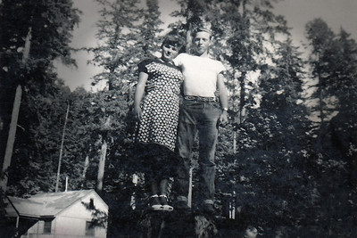 20. Gordon Lindy Gene Moore and  Alberta Florence (Johnson) Moore posed on the ever-popular stump, c. 1948 near Myrtle Creek, OR