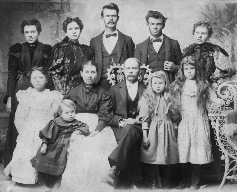 Mr and Mrs James R Caudle and family <br /> <br /> James Robert Caudle and Tennessee Petty Caudle are the great grandparents of Nedra Novice Patterson Austin.<br /> <br /> Rebecca Rosa Ann Caudle Keith (top right in the photo) is the grandmother of Nedra Novice Patterson Austin. <br /> <br /> ******************<br /> The Children of J R and Rosa Caudle, listed in birth order (not in the order pictured) are:<br /> <br /> Sara Jane Caudle , born Dec 31-1869 in Hopkins County TX<br /> <br /> William Wesley Caudle , born Nov 20 1872 in Hopkins County, TX<br /> <br /> James Jackson Caudle, born Dec 1874 in Hopkins County, TX<br /> <br /> Rebecca Rosa Ann Caudle, born March 2, 1877 in Erath County , TX<br /> <br /> Mary Eudella Caudle, born Junme 20, 1879 in Erath County , TX<br /> <br /> Lavina Belle Caudle, born Dec 8, 1881 in Erath County, TX<br /> <br /> Joseph Thomas Caudle, born Feb 6 1884 in Erath county TX<br /> <br /> Cora Etta Caudle, born June 1, 1886 in Erath County , TX<br /> <br /> Tennessee Elizabeth Caudle, born Sept 20, 1888 in Erath County , TX<br /> <br /> Amanda Lenora Caudle, born Jan 29, 1892 in Erath County, TX<br /> <br /> George Temple Caudle, born Feb 28, 1895 in Erath Co, TX