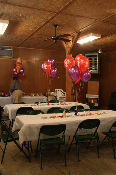 """The tables set up in Mommy's studio. Daddy is in the background at the """"drink"""" table."""