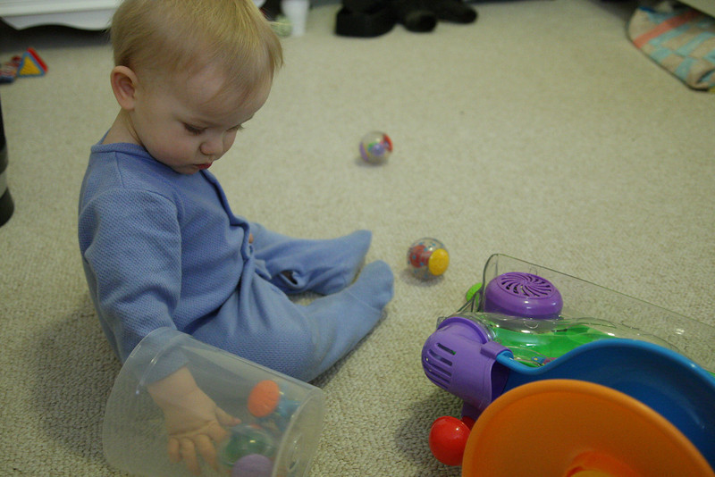 He loves clear things, and he loves taking objects out of things and then putting them back in. So this CD container top was a perfect way for him to play with these.