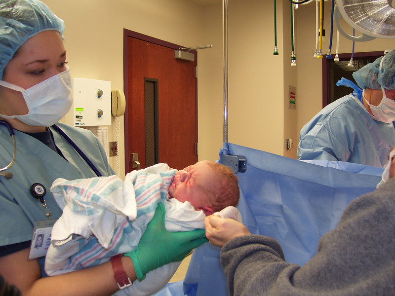 Isn't he beautiful?! And here he looked like he actually had the curly red hair I had jokingly predicted. Once it was dry, though, it looked quite different. Anderson's nursery nurse, Ashley, is holding him here. MamaBain said that when Anderson's head popped out, she saw Ashley's eyes pop open - wide! He was a big baby, after all...