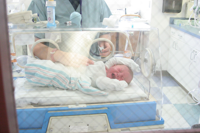 He's mad as fire, but healthy. Later, several people would say that he was a miracle. It seems he had been quite difficult to deliver even by C-Section. When Dr. Young came out to speak with the family, he told them that Anderson had had the cord wrapped around him six times in various places, at least once around his arm. Not only did he have to unwind the cord, he also had to chase him as he tried to get away from the doctors hands. Later I would realize just how scary all of this was. I had hoped he could be delivered naturally, but if we had tried, Dr. Young said we would have been pushed into an emergency C-Section. With the cord wrapped around him so many times, it really is a miracle it didn't choke him or cut off his circulation or that the blood and oxygen flow through the cord wasn't interrupted. God sure knows what He's doing!!! He made it impossible for us to try to deliver him any other way!