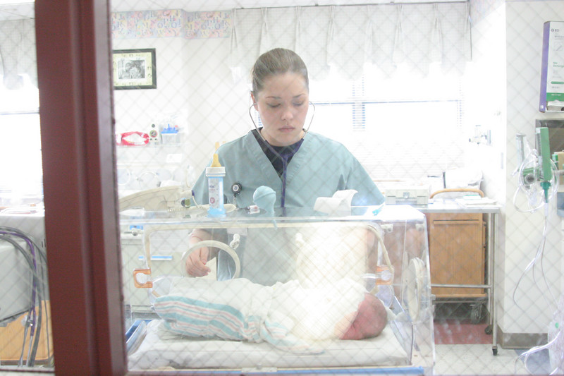 Being checked by his nurse. We saw her a few months later at Cracker Barrel, and Anderson was able to visit with her for a few minutes. She seemed genuinely excited to see him. Notice the little bottle on the top of the incubator. He was to be a breast-fed baby, but his blood sugar was low, and they had no choice but to give him some sugar water to try to get it up to normal. They said the low blood sugar was fairly normal with larger babies.