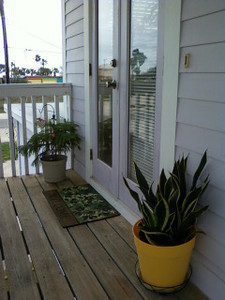 Front door. There is a table to the left of this picture on this patio. This patio is actually pretty big and usefull. You can look at towards the water.
