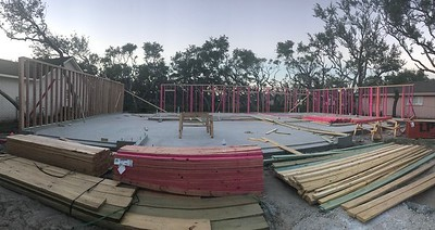 Garage in picture is 9'. Have a pony wall on top of this that takes it to 14'. So 5' more coming.   Then roof, this house is going to be tall.