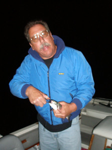 Paul with a fish that swallowed the hook.