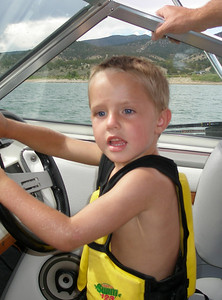 Jackson driving the boat