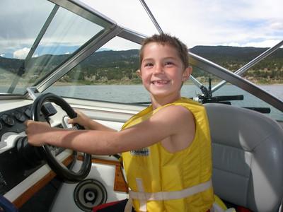 AJ driving the boat