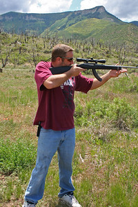 Andrew Shooting a 22 Ruger with a 100 yard scope and a 25 round magazine.