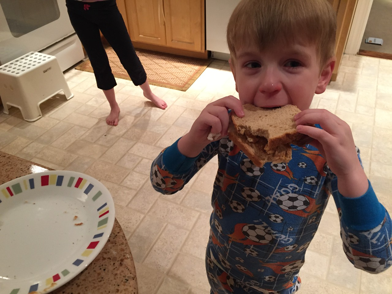 His first sandwich!!! Crunchy peanut butter, real marshmallows on wheat bread (we didn't have Fluff)