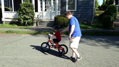 riding a bike (with training wheels)
