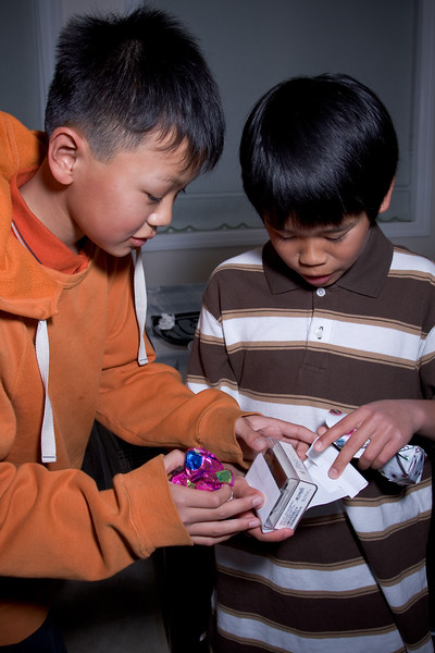 Andrew gets help opening his new iPod nano.