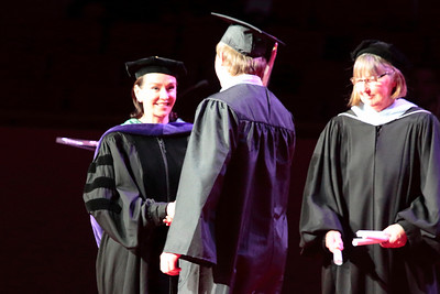 Andrew receives his diploma