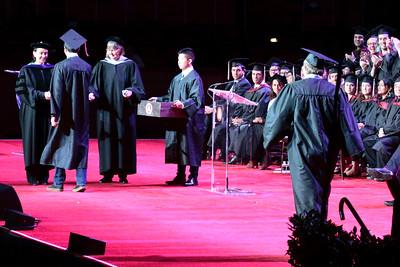 Andrew walks onto the podium