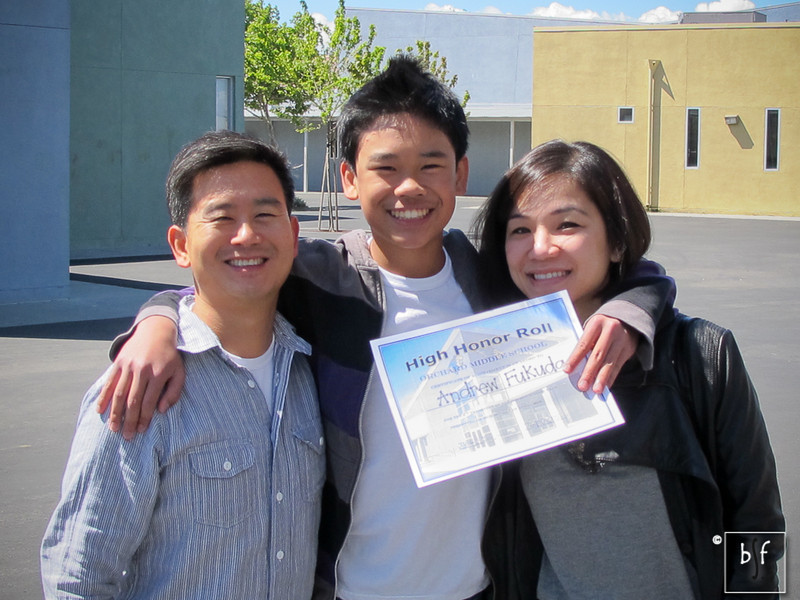 Ms. Forrest, one of Andrew's teachers, took this photo of the three of us. Somebody is on his tippy-toes!