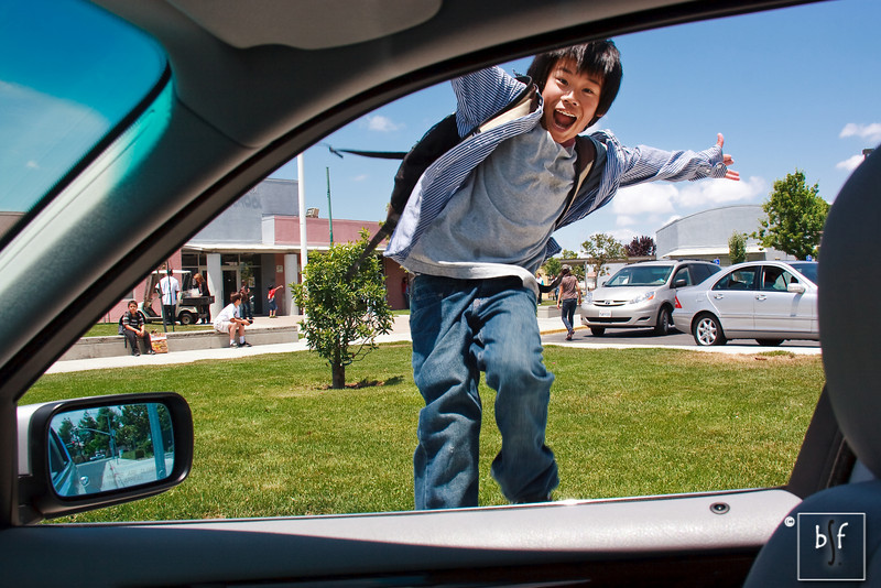 Andrew jumps for joy on the last day of school.