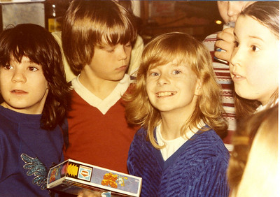 One of my birthdays.  Probably in 3rd or 4th grade.  Again, long hair.  My best friend Kelly is on the far left, my crush at the time is in between us (hence my huge grin!) and then me with my toothy grin - probably in between braces and after I'd had some teeth pulled before round two.