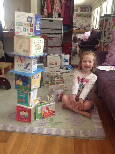 Book tower - Annabel did the small one in the background by herself; Mommy helped with the tall one.