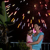 Look, mamma!  Annalise points at the camera flash while the fireworks go off. - shot @ ISO 250, f/5.7, 1/4 sec, on Panasonic DMC-GH2 w/ LUMIX G VARIO 14-140/F4-5.8 lens at 67 mm