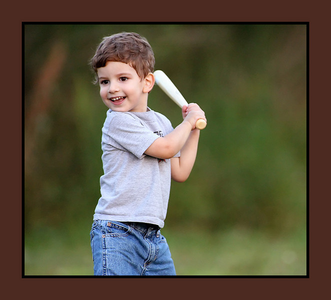 Another candid while playing baseball.  He's pretty darn good with the bat, and he's already got a great arm.