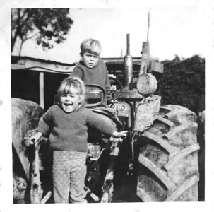 Anthony and Kim Tractor Hexton Farm 1960s  Kim and Anthony on the farm tractor, Hexton, Gisborne  Apparently when I was about two years old I climbed up on the tractor and started it up (so I've been told) and my dad had to jump up onto the tractor to turn it off. I have no idea if this is a true story but I remember being told it - good story if it's true I guess?