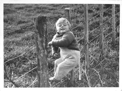 Anthony Climbing Fence Hexton Farm 1960s   I am guessing this 1964, as I am guessing I must be about two years old in this photo, but who knows?  This goes with this: www.flickr.com/photos/nztony/2972954971