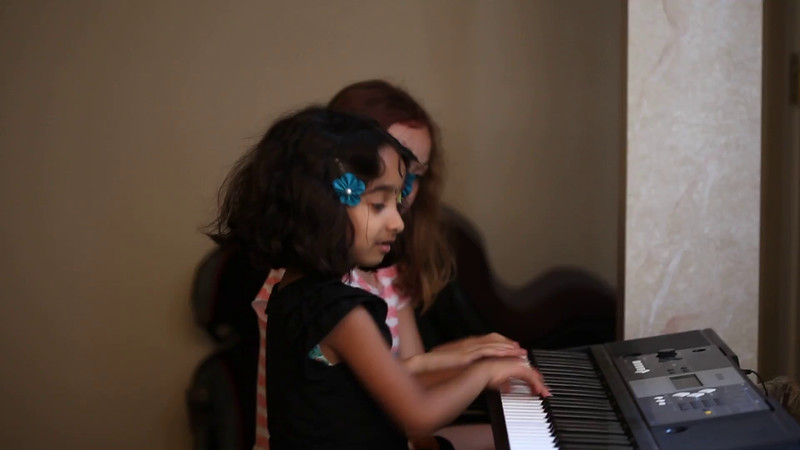 20160625 7-year-old Anuragini (1649) - goofing off w Julia on keyboard