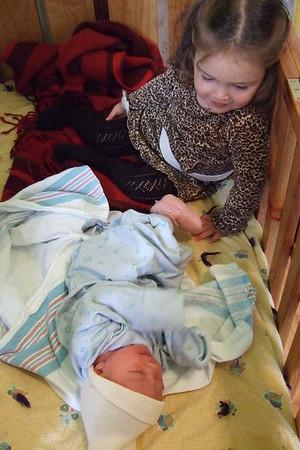 Guen shares her crib.