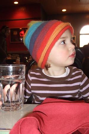 Anya in her rainbow hat.