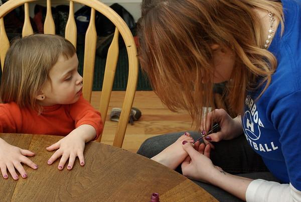 Anya gets her toenails done.