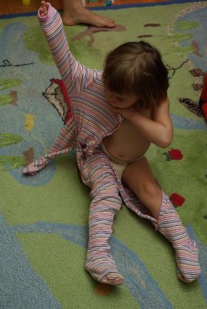 Anya gets herself dressed.