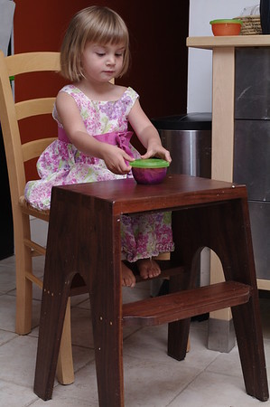 Anya proudly sets up her own little table.