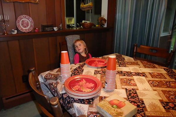 Anya waits for dinner at Grandpa and Grandpa Miller's.
