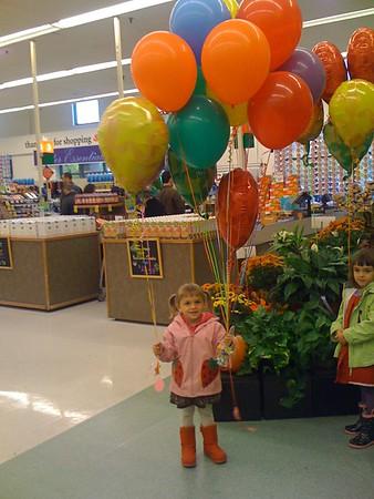 Birthday balloons; Guen is a little jealous.